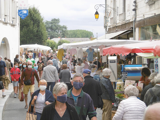 Shoppers wearing cloth masks in the market at Loches. Indre et Loire. France. Photo by Loire Valley Time Travel.