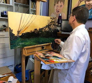 Artist David Borden painting transmission towers and tree landscape oil painting in his studio.