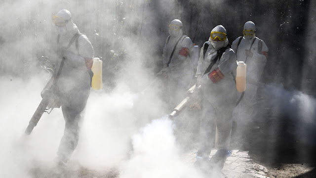 Image 2: Workers spraying disinfectant to protect against the novel coronavirus In Bozhou, China, Feb 2020. Example of an infectious disease. Photograph: Getty Images.