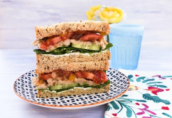A vegan white bean and tomato sandwich