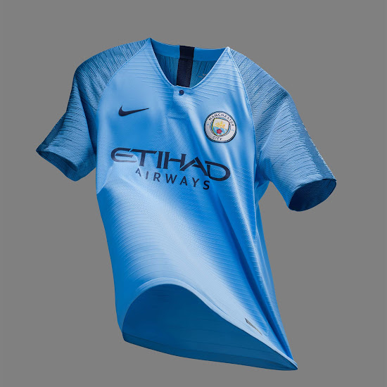 2148c3d7cebd8 While the Etihad Airways tag on the front of the Manchester City 18-19 home  kit is navy