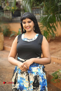 Actress Model Poorni Stills in Floral Long Dress at Silk India Expo Launch  0007.JPG