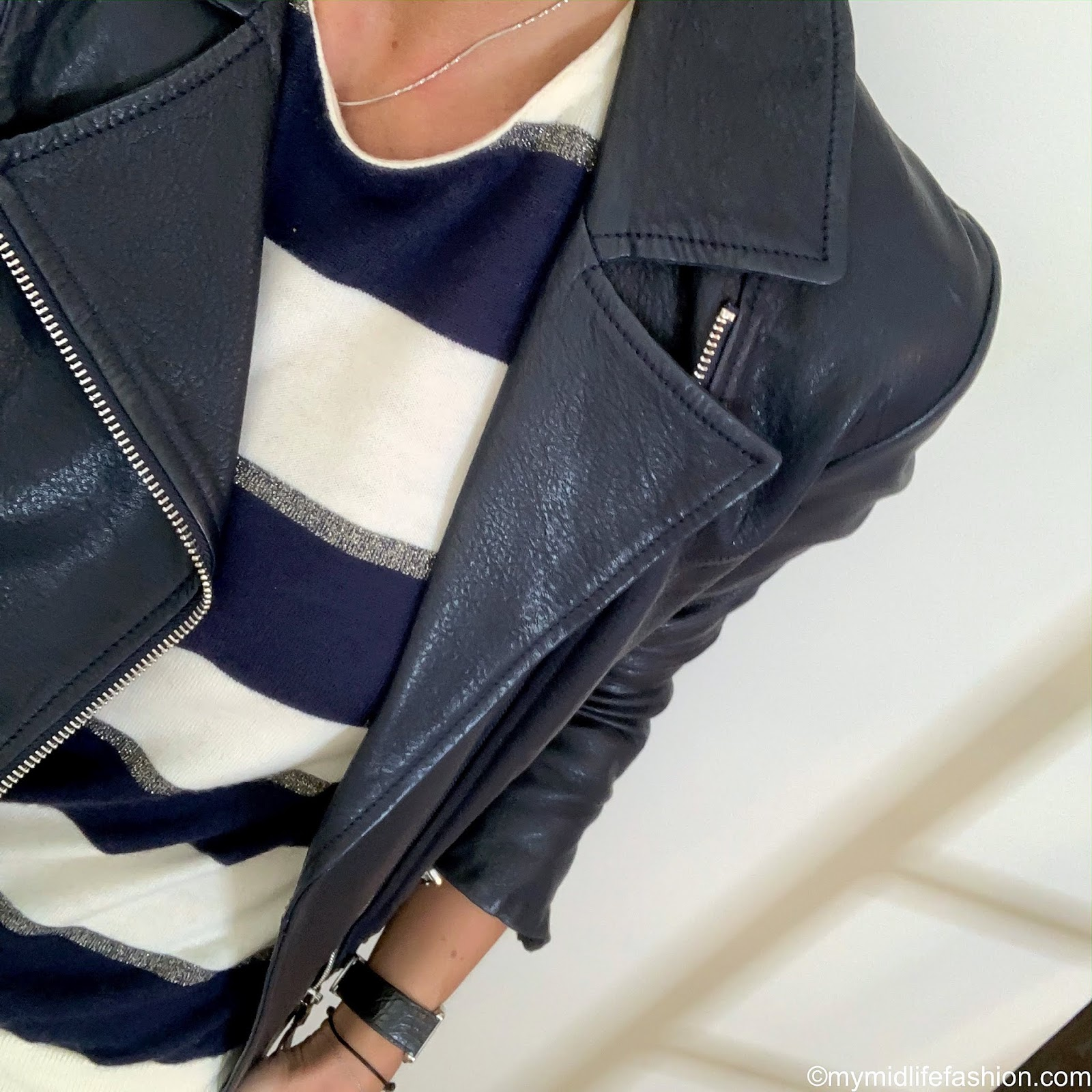 my midlife fashion, Massimo Dutti leather biker jacket, Joseph stripe cashmere jumper, golden goose superstar low top leather trainers, marks and Spencer straight leg ⅞ wool trousers