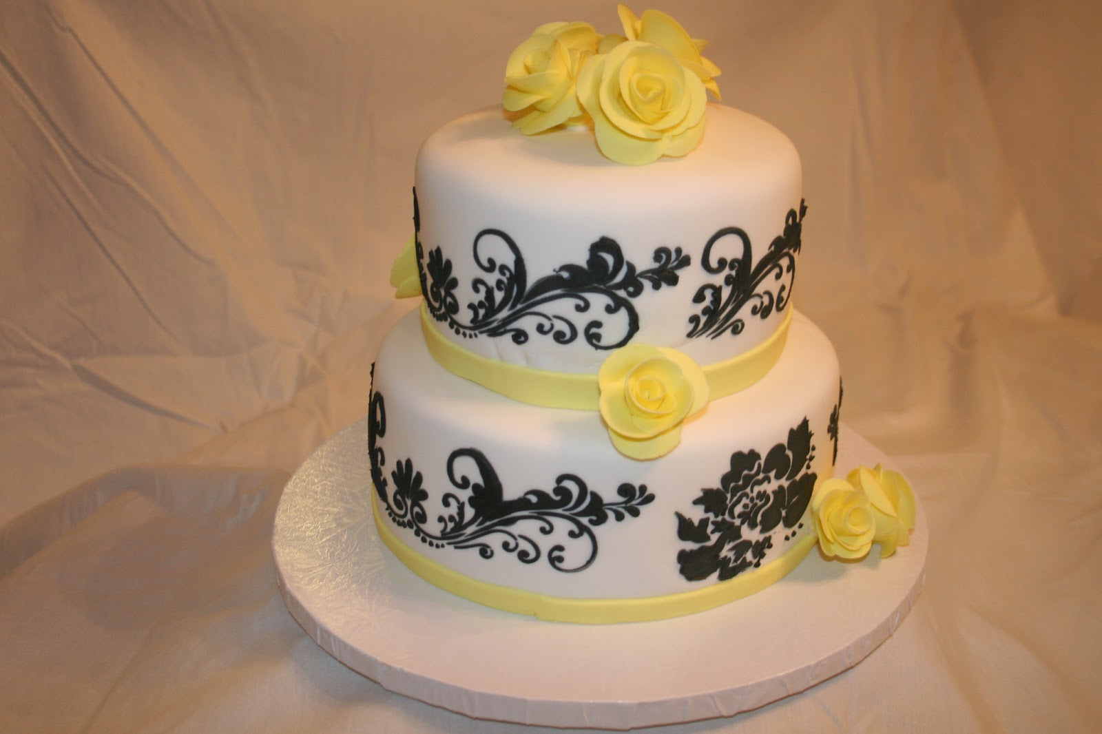 white wedding cake with yellow roses s creative cakes wedding cake with yellow roses 27426