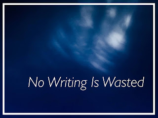 Dark blue sky with a blurry glimpse of white clouds with the words: No Writing Is Wasted in white on the bottom