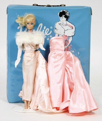 Barbie wearing pink evening gown with faux fur stole and white gloves