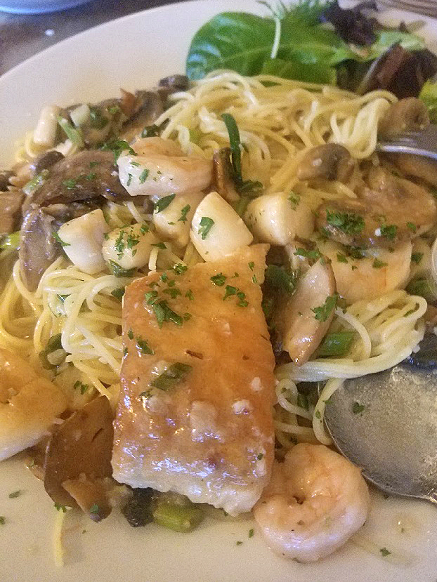 this is pan seared scallops shrimp and sea bass over linguine with a wine and lemon butter sauce