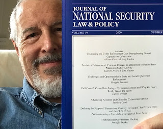 Photo of Journal of National Security Law & Policy with Stephen Cobb smiling