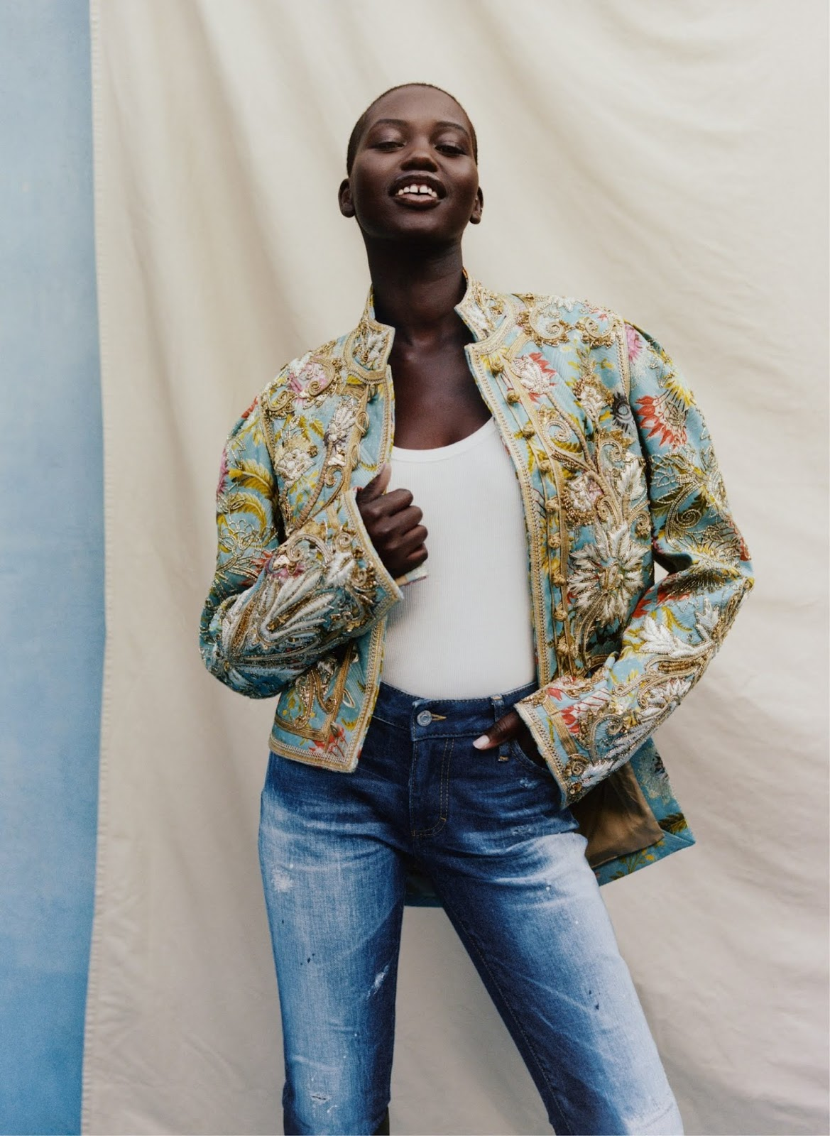 Adut Akech - Dries Van Noten jacket and tank top. Dsquared2 jeans. Photographed by Tyler Mitchell, Vogue, April 2020