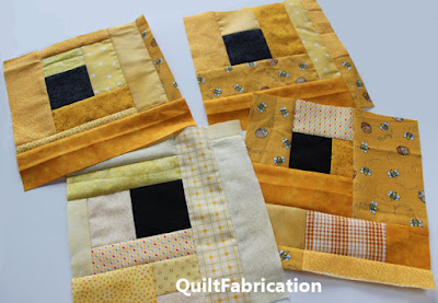 yellow quilt blocks with an offset black square