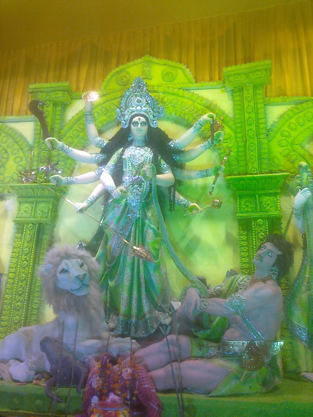Green colored durga murti in pujo kolkata howrah 2011 year