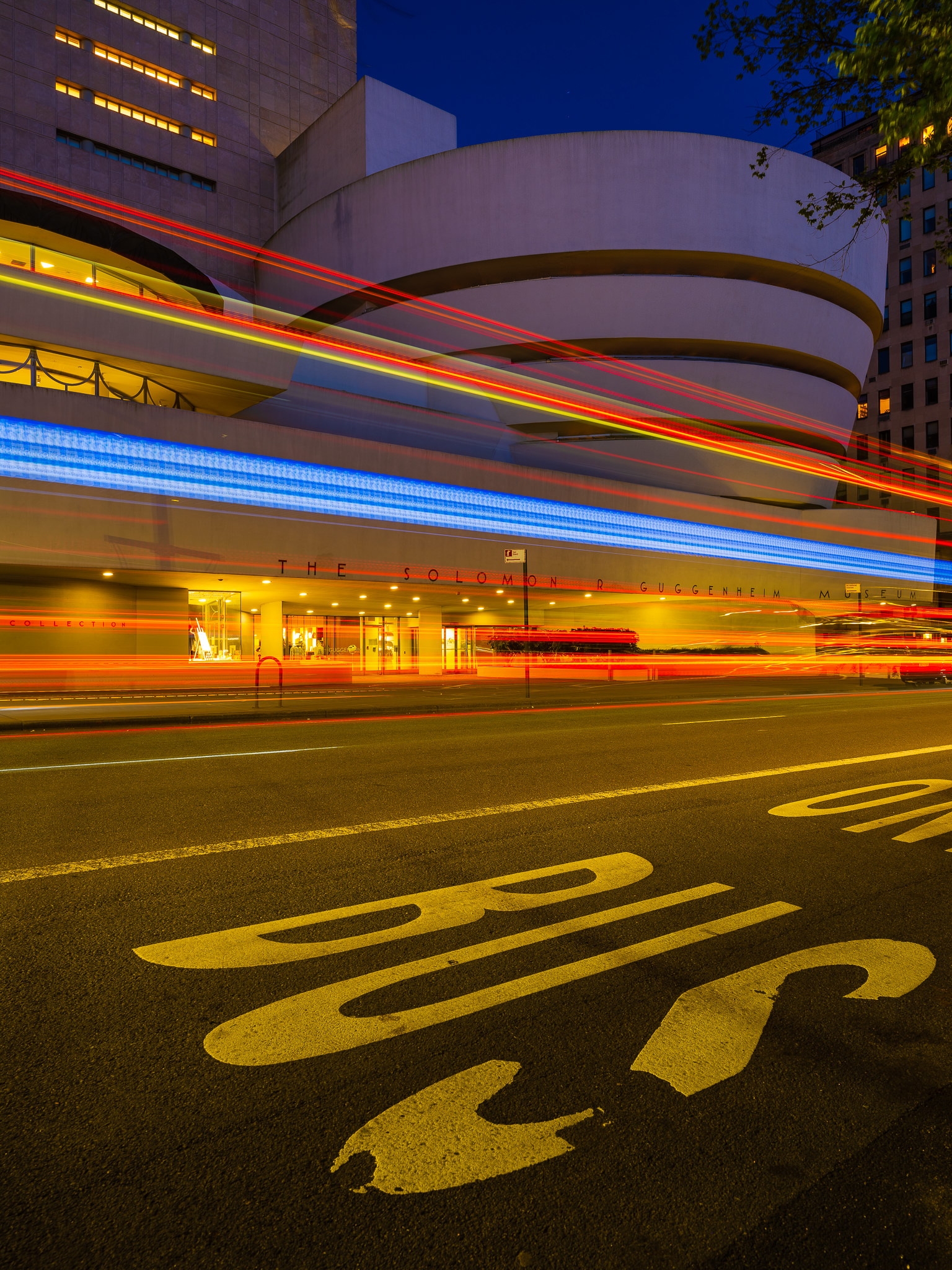 a photo of the guggenheim museum at night on fifth avenue in new york city