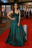 Raashi Khanna in Dark Green Sleeveless Strapless Deep neck Gown at 64th Jio Filmfare Awards South ~  Exclusive 077.JPG