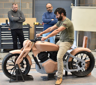 Man sits on full-size clay model of the Concept Kx.