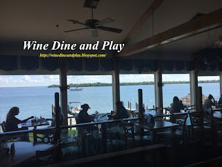 The dining room with a water view at The Green Flash restaurant in Captiva, Florida