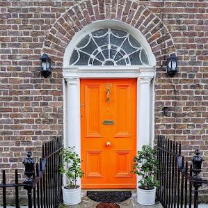 Orange Dublin door on Mountpleasant Square in Ranelagh