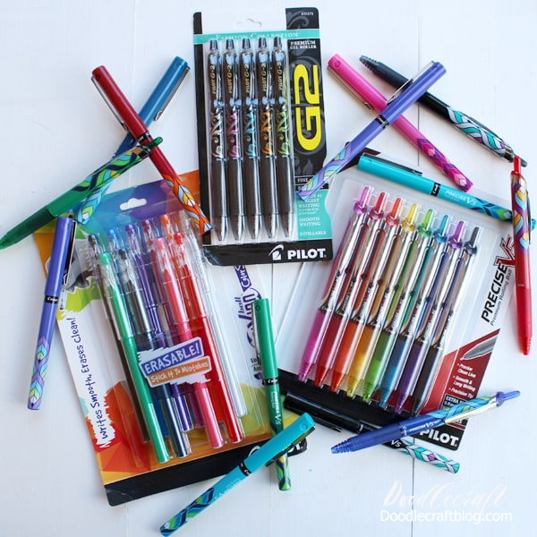 Pilot Pens scattered on table showcasing many varieties and colors of Pilot pens, precise, G2 and Frixion color sticks