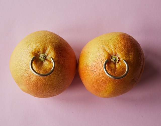 An image of apparently 2 Oranges with rings, but the mind might think about something else, so yes this image was meant to grab your attention!