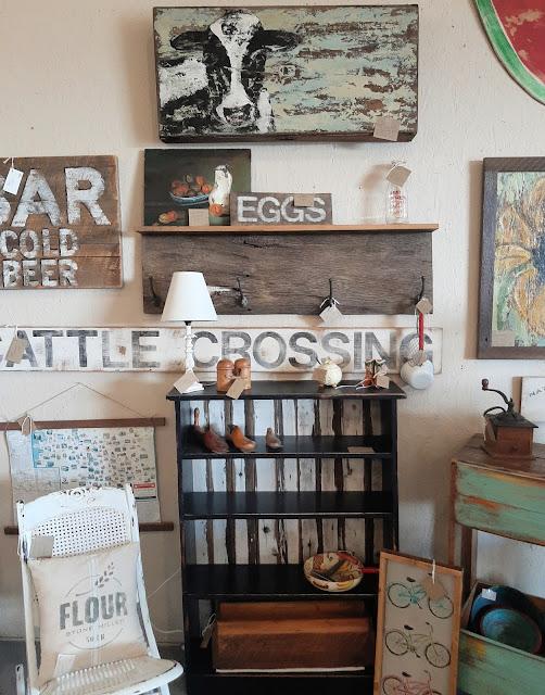 bookshelf, reclaimed barnwood, cattle crossing sign, cow painting