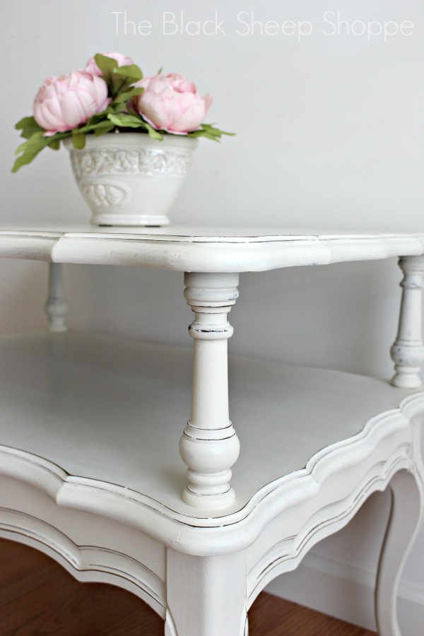 French Provincial style two-tiered end table.