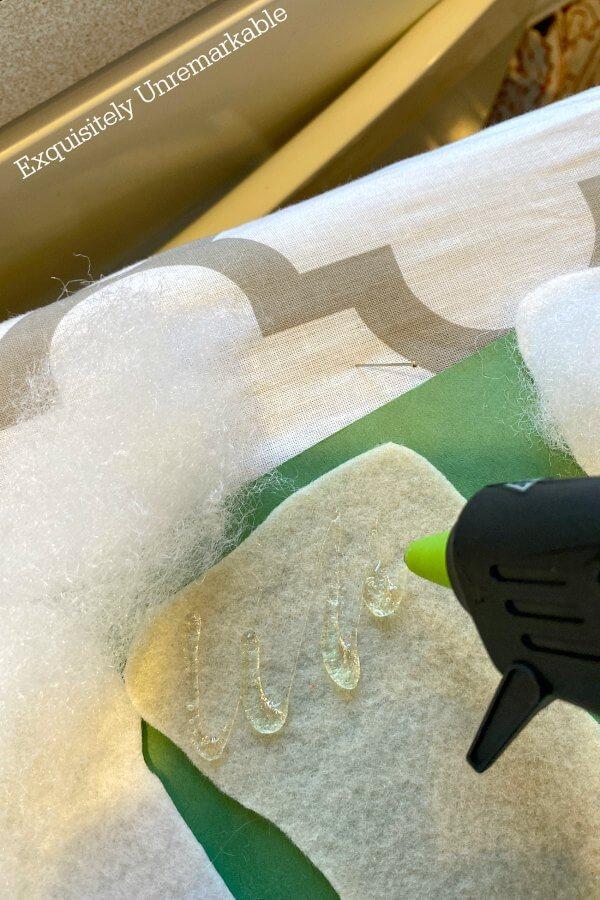 Using Hot Glue To Add Polyfill To Felt Stocking
