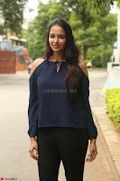 Poojita Super Cute Smile in Blue Top black Trousers at Darsakudu press meet ~ Celebrities Galleries 020.JPG