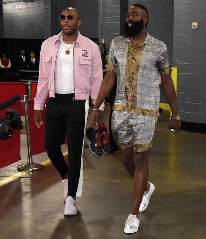 James Harden and P. J. Tucker at Toyota Center playoff round two game.