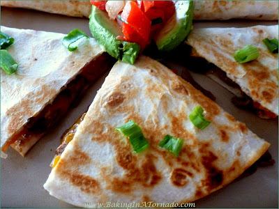 Steak Fajita Quesadillas: All the flavors of a fajita in a pan fried crunchy quesadilla | Recipe developed by www.BakingInATornado.com | #recipe #lunch #dinner