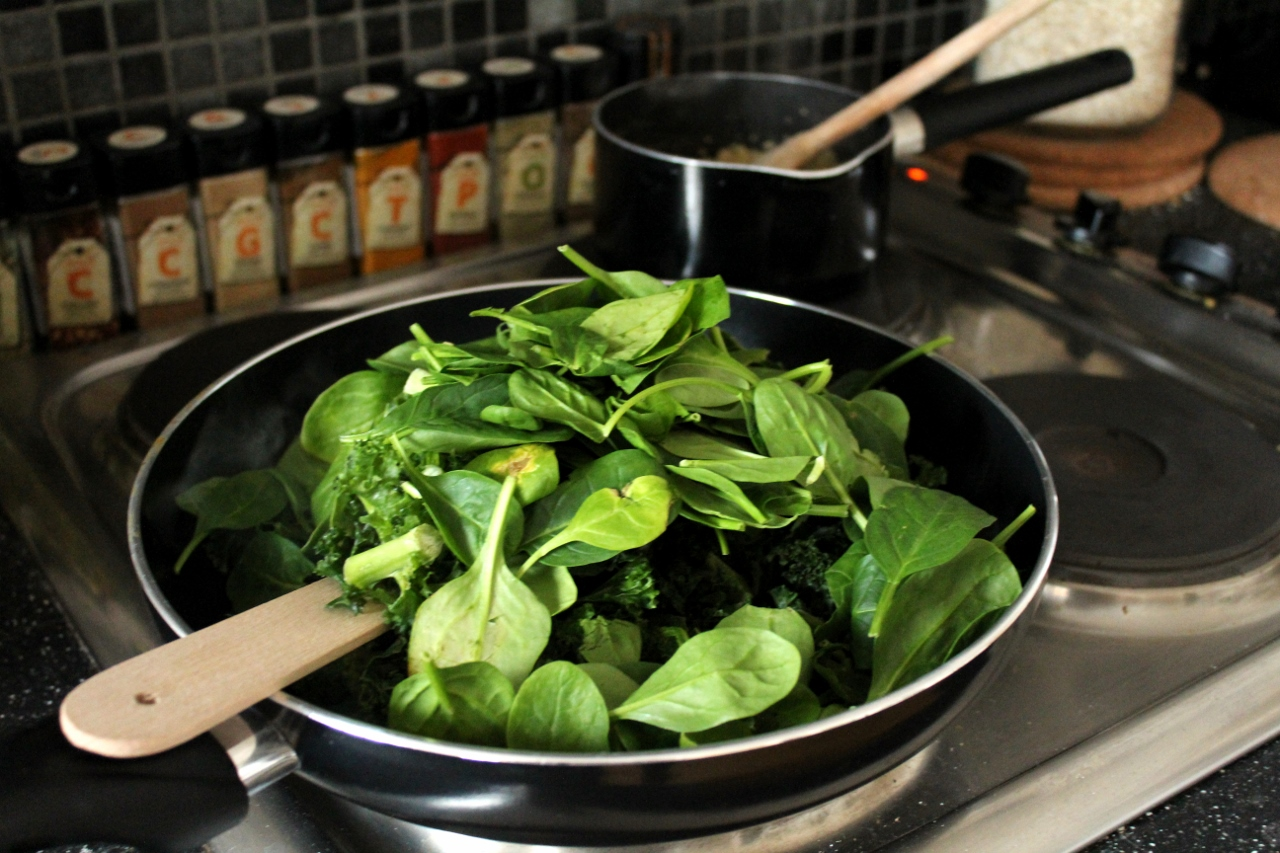 Spinach and kale in frying pan