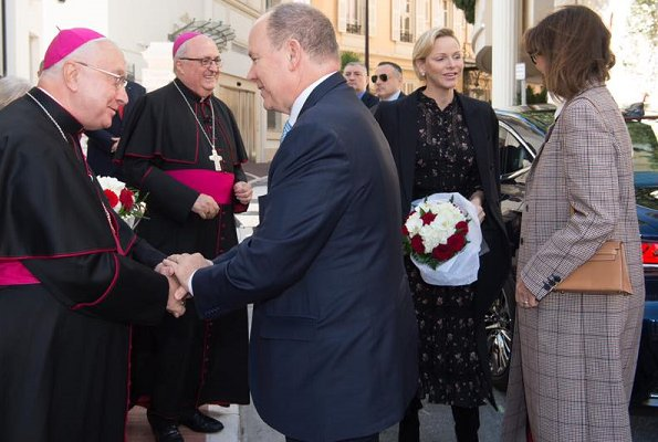 Princess Charlene wore Polo Ralph Lauren floral georgette dress. Princess Caroline of Hanover wore Prada wool-blend coat