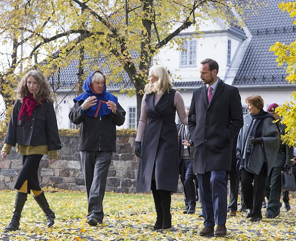 Crown Princess Mette Marit wore Valentino Cape, Prada wool sweater, Prada Boots, diamond earrings