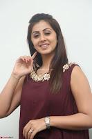 Nikki Galrani in a Brown Shining Sleeveless Gown at Nakshatram music launch ~  Exclusive 011.JPG