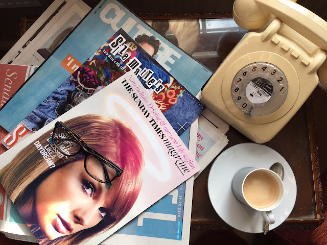 Sunday papers and vintage telephone