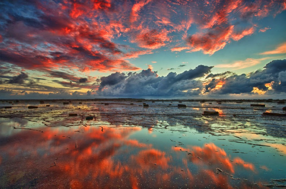 Beautiful red clouds over long reef, Australia