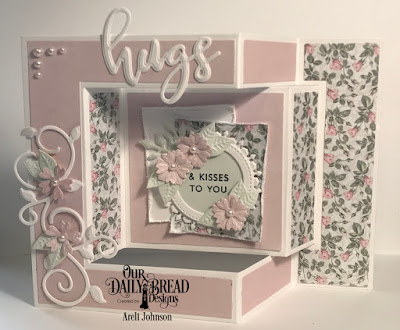 Stamp/Die Duos: Hugs  Custom Dies: Bitty Blossoms, Foliage & Leaves, Pierced Circles, Fancy Circles, Tri-Fold Card with Layers  Paper Collection: Romantic Roses