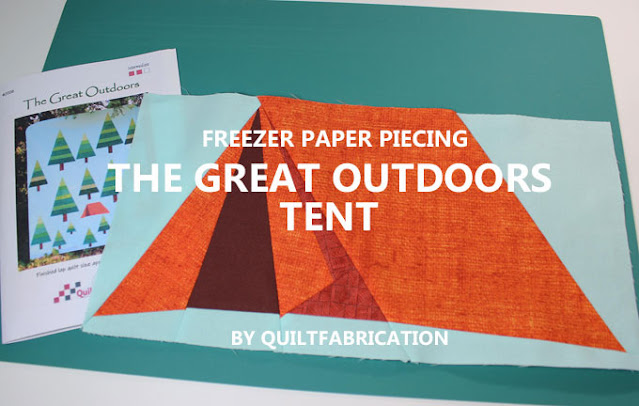 orange freezer paper pieced tent on an aqua background by QuiltFabrication