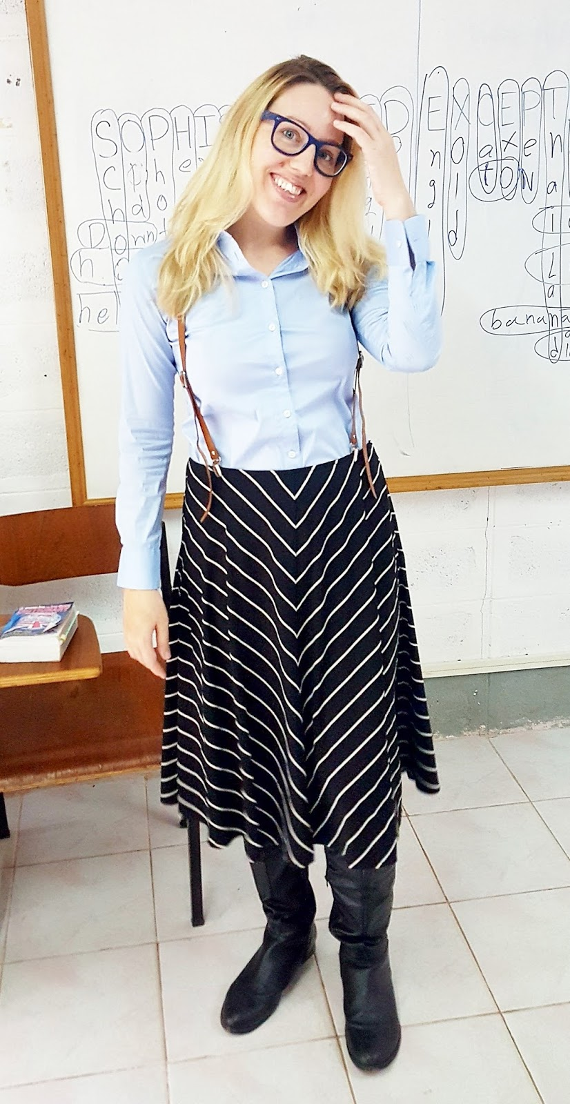cd81a52eb1c English teacher in Thailand wearing a long-sleeved blue button-up shirt and  a