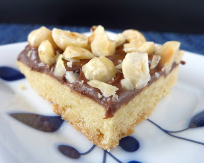Photo of Brown Sugar Hazelnut Bars: Brown sugar cookie base topped with Nutella and chopped hazelnuts