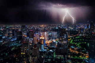 Lightning over city - by Dominik QN on Unsplash