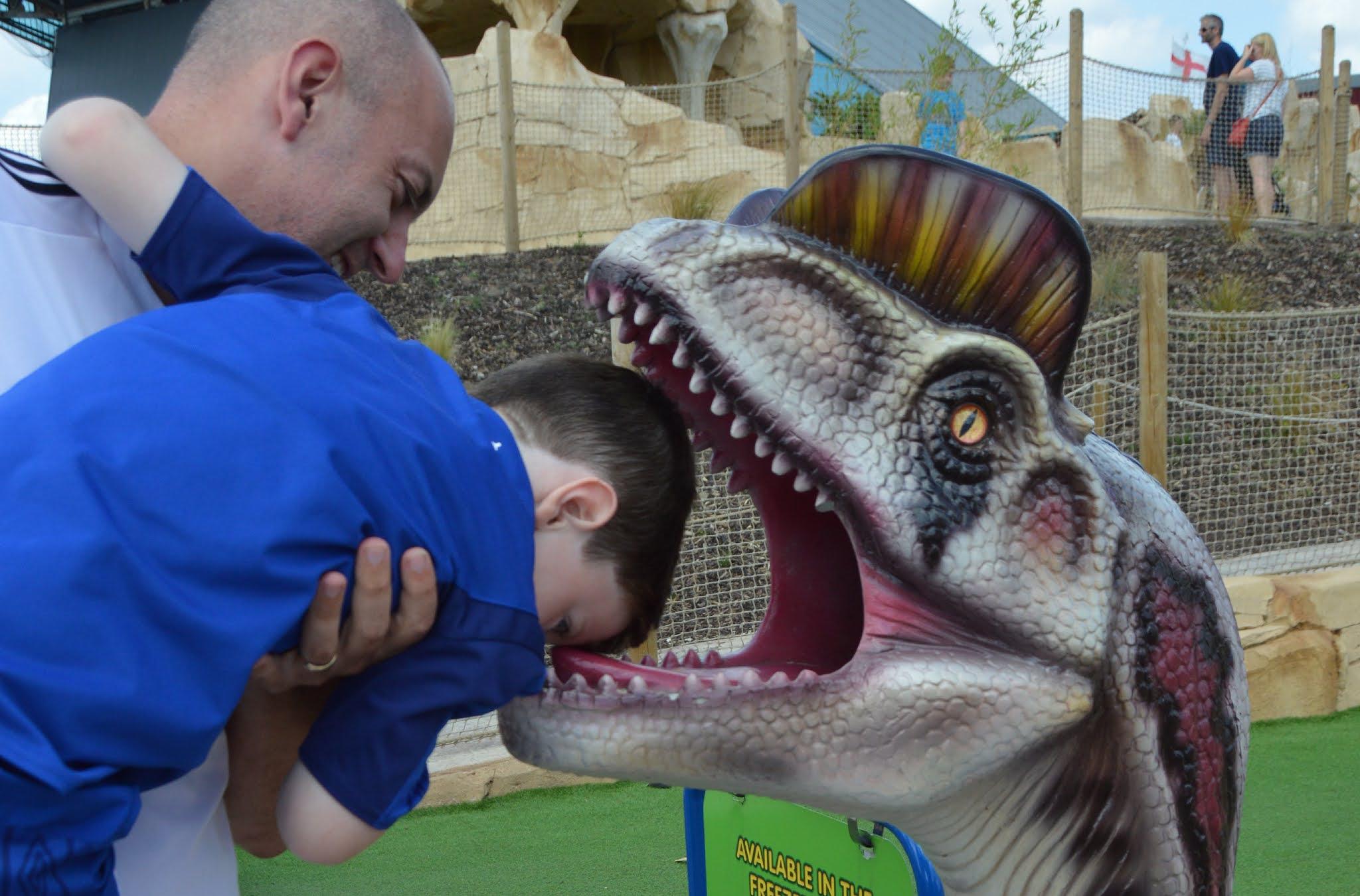 boys head in a tyrannosaurus rex