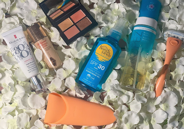 Beauty Products on White Floral Background