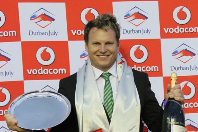 Horse racing trainer Justin Snaith celebrating his victory in the Vodacom Durban July