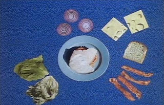 dancing foods come together and form the sandwich. Sesame Street Elmo's Magic Cookbook