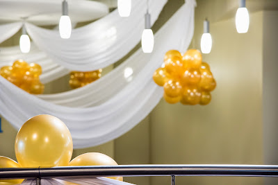 Graduation party planning and decoration. Balloons, drapes, flowers