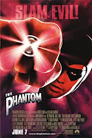 The Phantom poster showing Billy Zane in costume punching towards the viewer. A ring on his finger glows white.