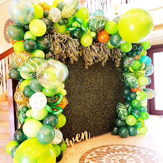 Greenery background with organic balloon garland for safari theme baby shower decoration ides