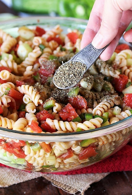 Adding Italian Seasoning to Ma's Picnic Pasta Salad Image