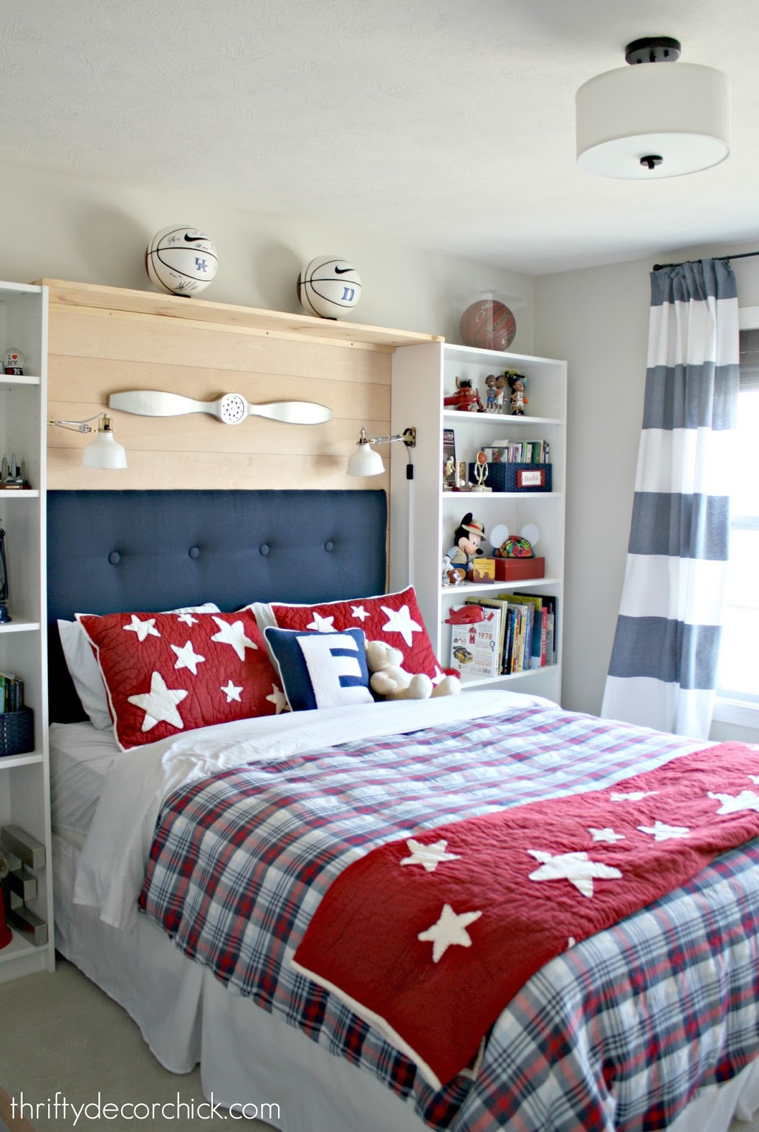 Red and blue boy room with storage