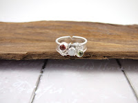 https://folksy.com/items/7133739-Wide-Band-Sterling-Silver-Ring-Peridot-Carnelian-and-Moonstone-Adjustable-