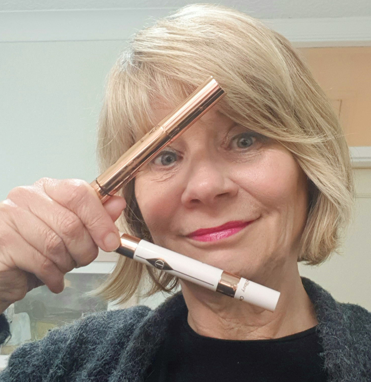 Beauty blogger Gail Hanlon with two concealers from Charlotte Tilbury
